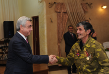 President hands State awards to a group of freedom-fighters
